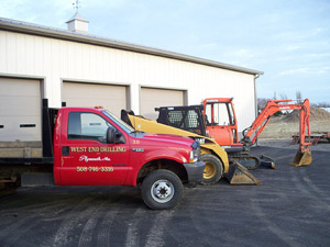 Photo of work truck and earth movers